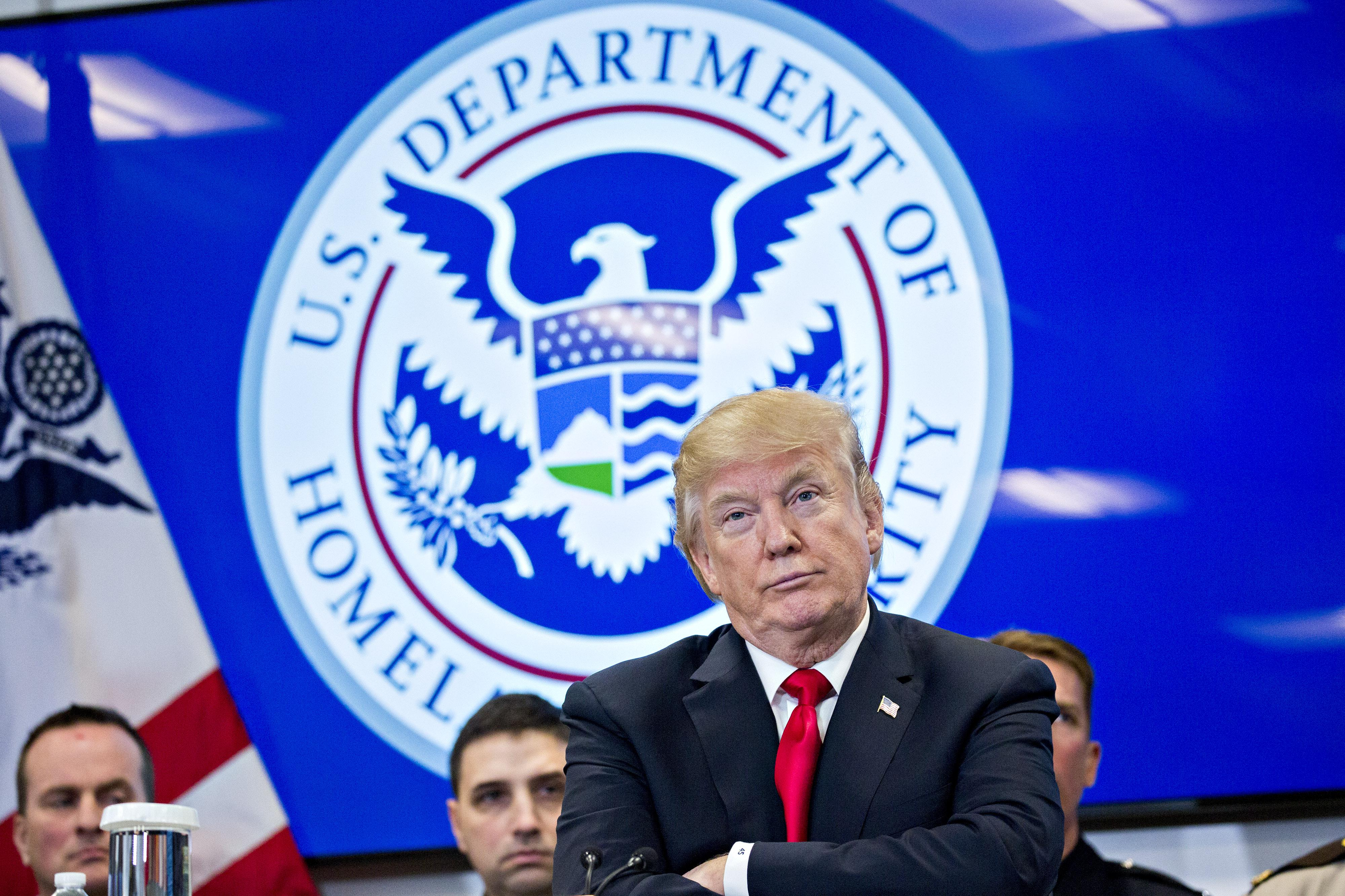 President Donald Trump listens while participating in a Customs and Border Protection (CBP) roundtable discussion after touring the CBP National Targeting Center February 2, 2018 in Sterling, Virginia. Trump is looking to ratchet up pressure on lawmakers to consider the immigration proposal he unveiled in Tuesday's State of the Union using the visit as an opportunity to again argue his proposal would bolster the country's borders.