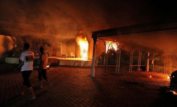 A vehicle and the surround buildings burn after they were set on fire inside the US consulate compound in Benghazi.