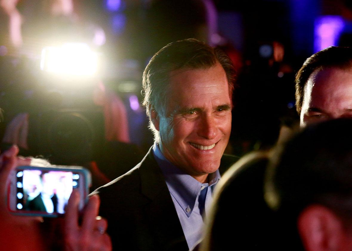 Mitt Romney is greeted by fellow Republicans.