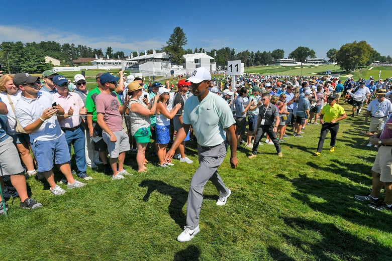 Tiger Woods walks along the 11th hole during the first round of the BMW Championship.