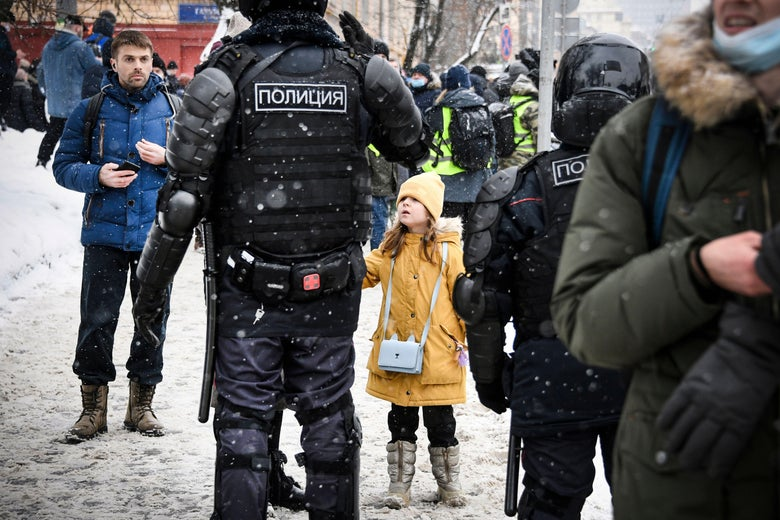 People talk to riot police during a rally in support of jailed opposition leader Alexei Navalny in Moscow on January 31, 2021.