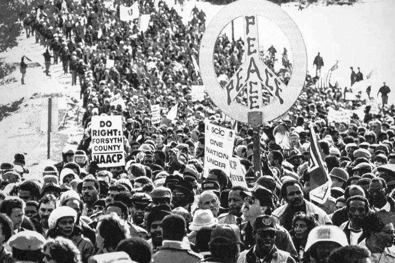 View of hundreds of civil rights marchers in January 1987.