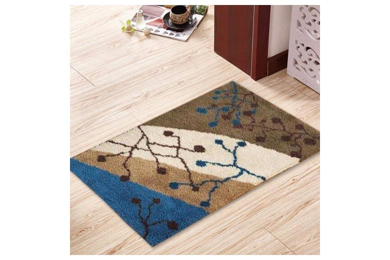 A rug with an abstract design on it.