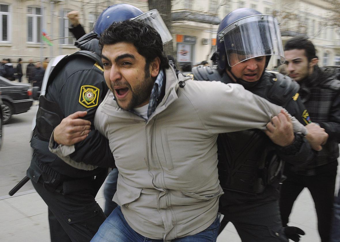 Azeri riot policemen detain protestors in central Baku on Januar,Azeri riot policemen detain protestors in central Baku on January 26, 2013.