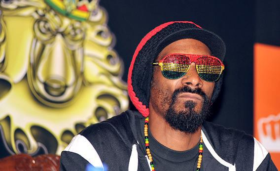 Rapper Snoop Dogg poses during a press conference in Mumbai.