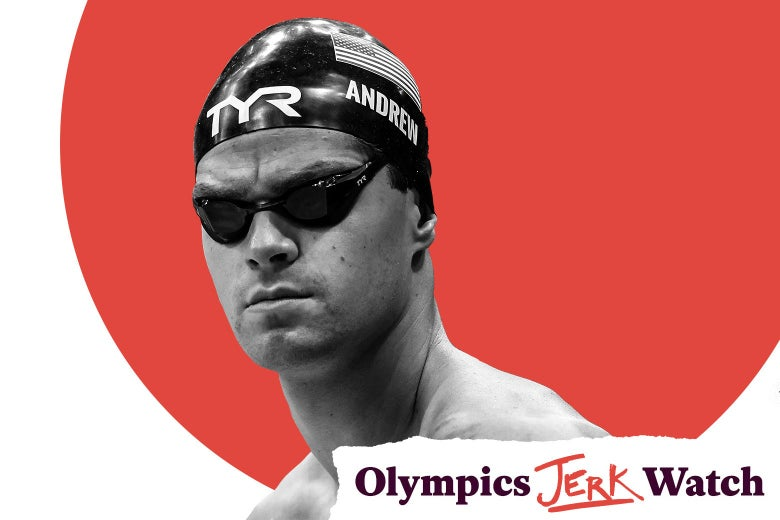 Andrew in goggles and swim cap from the chest up, grimacing