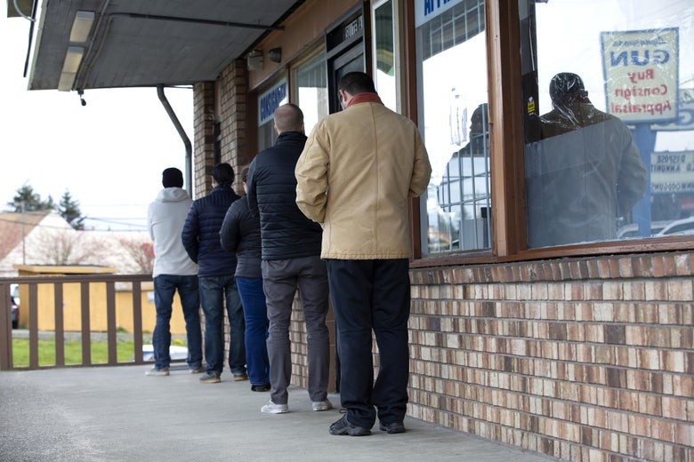 A line forms with people social distancing outside Lynnwood Gun on April 2, 2020 in Lynnwood, Washington.