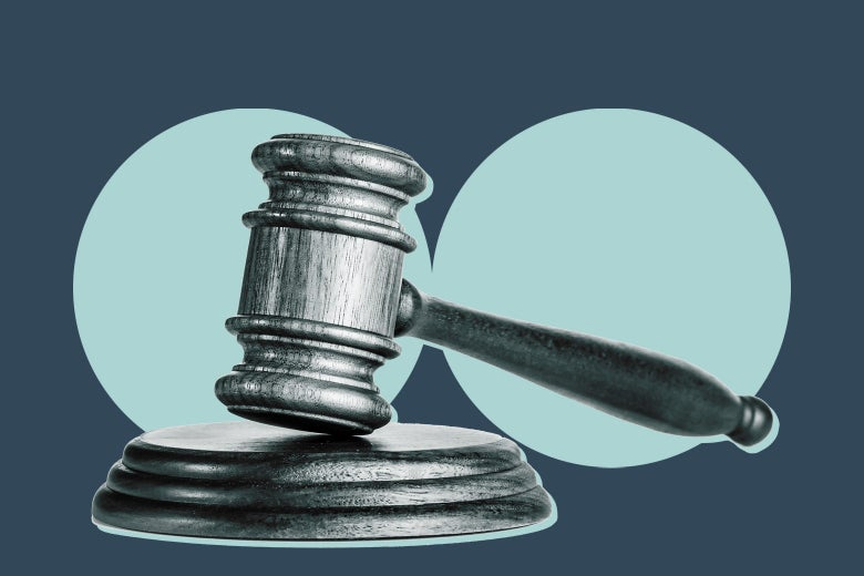 A gavel in front of two blue circles.