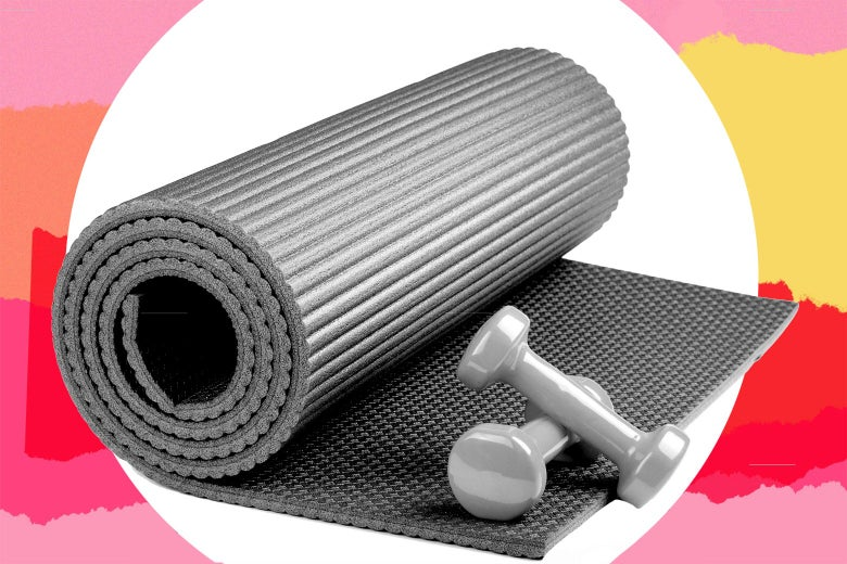 A rolled-up yoga mat and two weights.