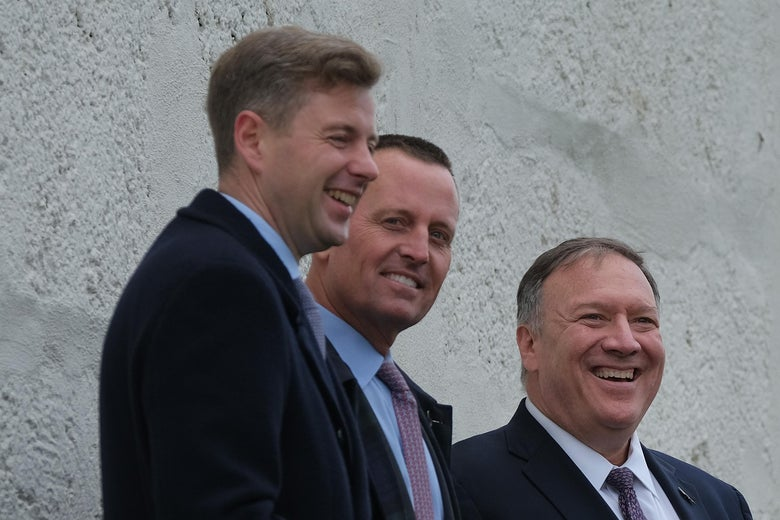 Grenell and Pompeo at a still-standing portion of the East Germany–West Germany border