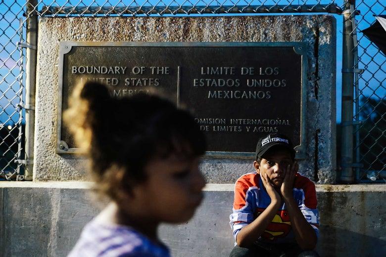 Honduran children seeking asylum wait on the Mexican side of the border near Brownsville, Texas, on Tuesday.