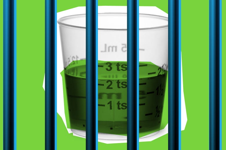 A cup containing a dosage of methadone behind bars.