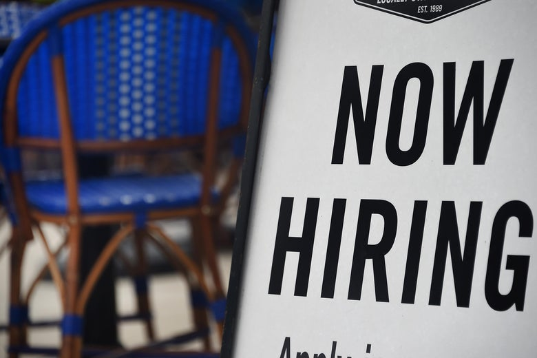 """A restaurant displays a """"Now Hiring"""" sign amid the coronavirus pandemic, on August 4, 2020 in Arlington, Virginia. (Photo by Olivier DOULIERY / AFP) (Photo by OLIVIER DOULIERY/AFP via Getty Images)"""