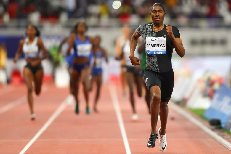 Semenya running on the track, ahead of her competition.