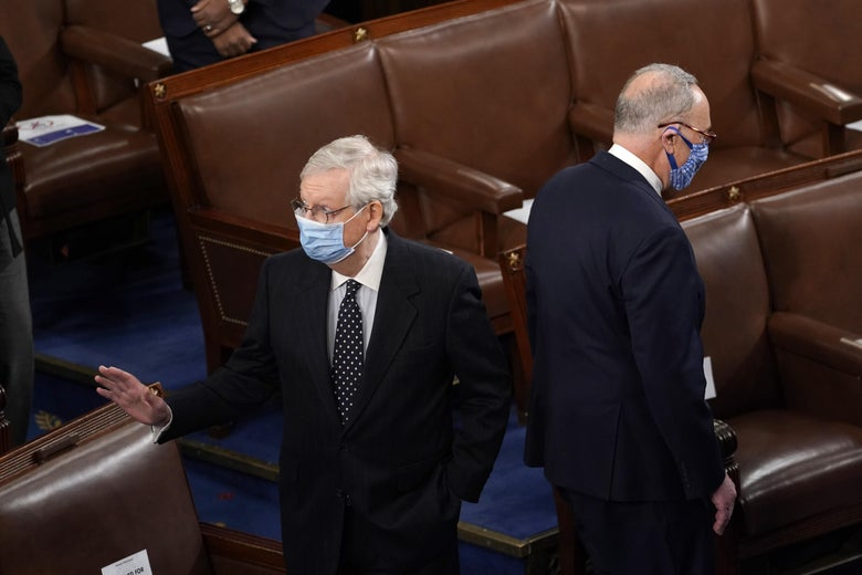McConnell and Schumer stand back to back in the House chamber