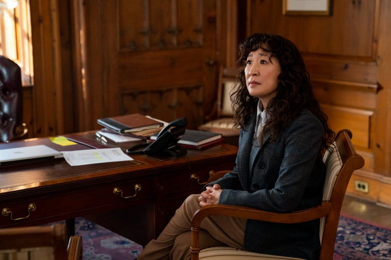 Sandra Oh as Dr. Kim in The Chair, sitting in a chair.