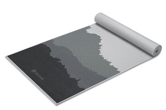 Gaiam yoga mat with mountain design.