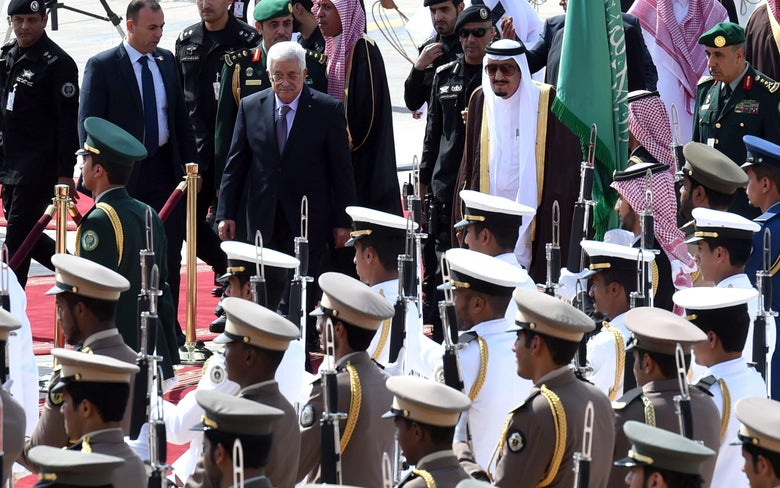 Saudi King Salman bin Abdulaziz (R) reviews the honor guard with Palestinian President Mahmoud Abbas during a welcome ceremony for this last held at King Khalid International Airport in Riyadh, on November 10, 2015. Arab leaders and senior South American officials converge on Saudi Arabia for a summit whose objective is to strengthen the links between geographically distant but economically powerful regions. AFP PHOTO / FAYEZ NURELDINE (Photo credit should read FAYEZ NURELDINE / AFP / Getty Images)