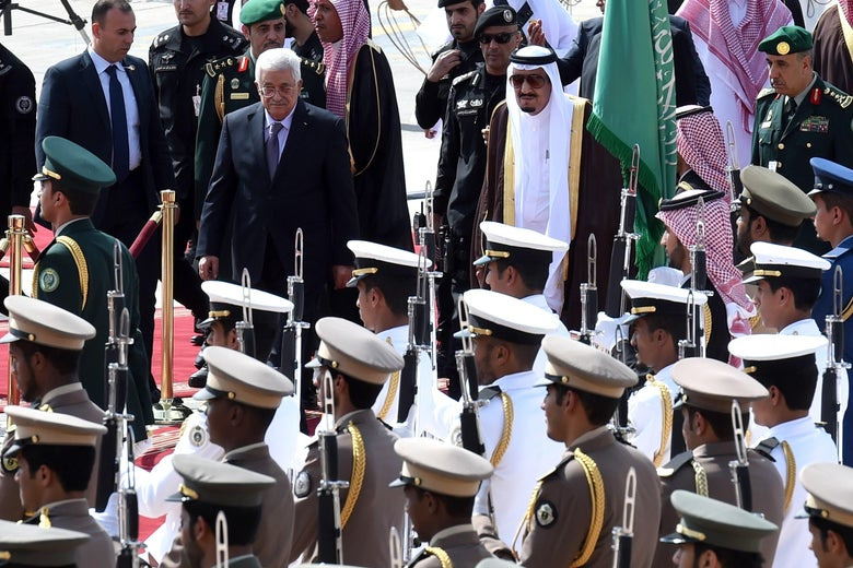 Saudi King Salman bin Abdulaziz (R) reviews the honour guard with Palestinian President Mahmoud Abbas during a welcoming ceremony for the latter held at King Khalid International Airport in Riyadh, on Nov. 10, 2015. Arab leaders and top officials from South America are converging on Saudi Arabia for a summit aiming to strengthen ties between the geographically distant but economically powerful regions. AFP PHOTO / FAYEZ NURELDINE        (Photo credit should read FAYEZ NURELDINE/AFP/Getty Images)