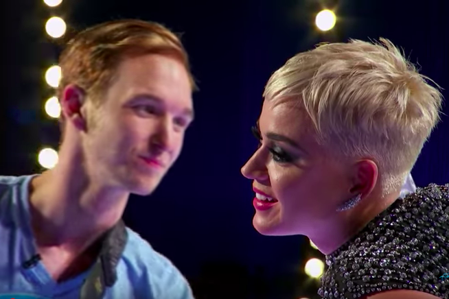 American Idol contestant Benjamin Glaze prepares to give Katy Perry what he thinks will be a kiss on the cheek.
