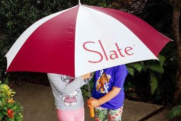 kids standing under a Slate umbrella