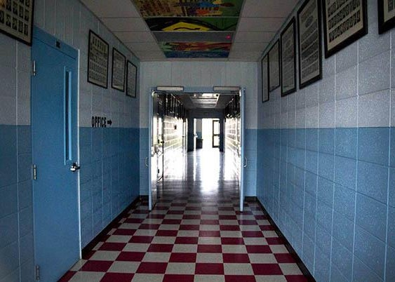 The empty hallway of Homedale High School in Homedale, Idaho, on a recent Friday.