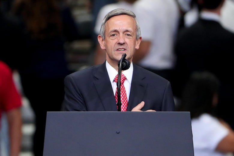 Robert Jeffress stands in front a lectern, speaking into a microphone.