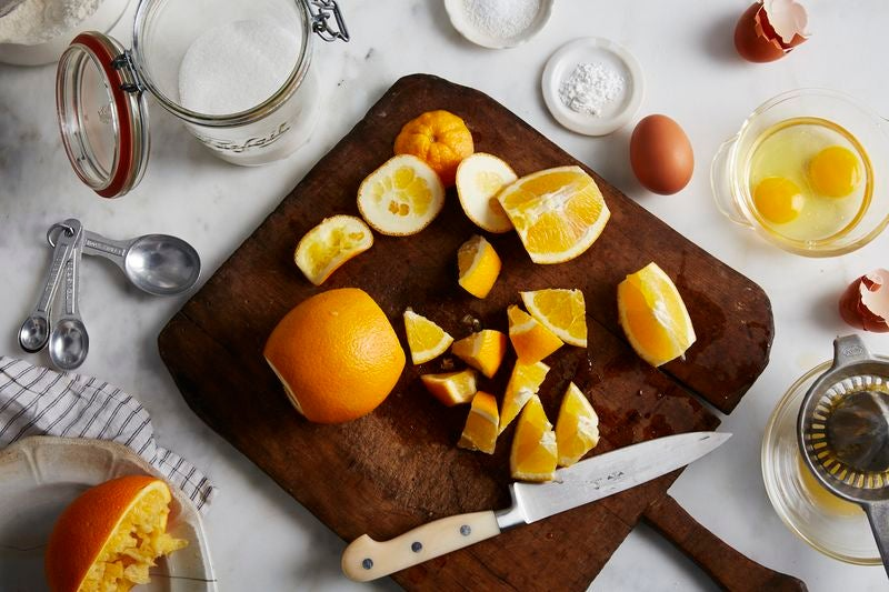 Chopped up oranges on a chopping board