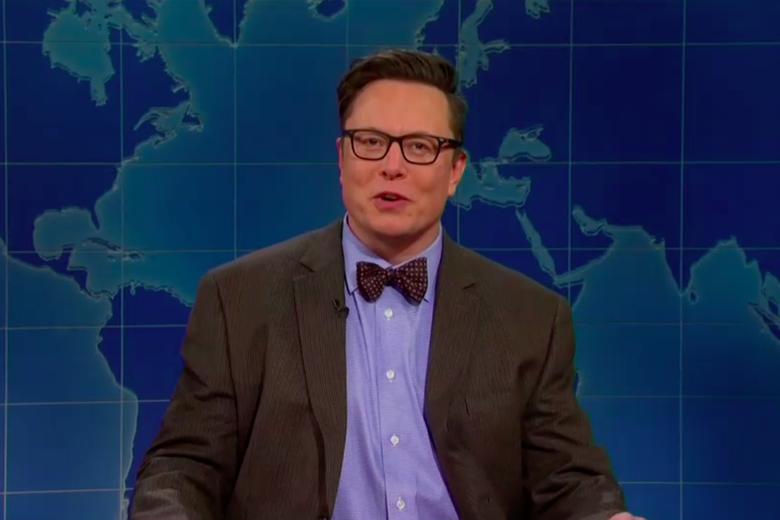 "Elon Musk wearing glasses, seen on the ""Weekend Update"" set."