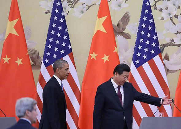 Chinese President Xi Jinping and President Obama walk on stage before their press conference announcing a climate deal at the Great Hall of People on Nov. 12, 2014, in Beijing