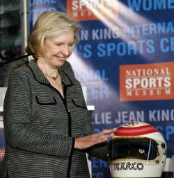 Janet Guthrie, the first woman to earn a starting spot in the Indianapolis 500 and the Daytona 500 in 1977, looks at her helmet.