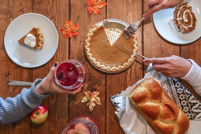 A table set with pumpkin pie.