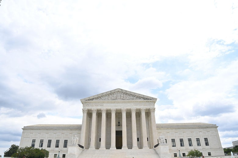 The Supreme Court building and a partly cloudy sky.