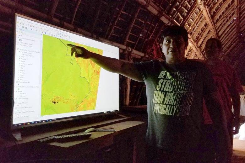 Yanamá Kuikuro, president of the Kuikuro Indigenous Association of Upper Xingu, points to a satellite image of the Kuikuro territory.