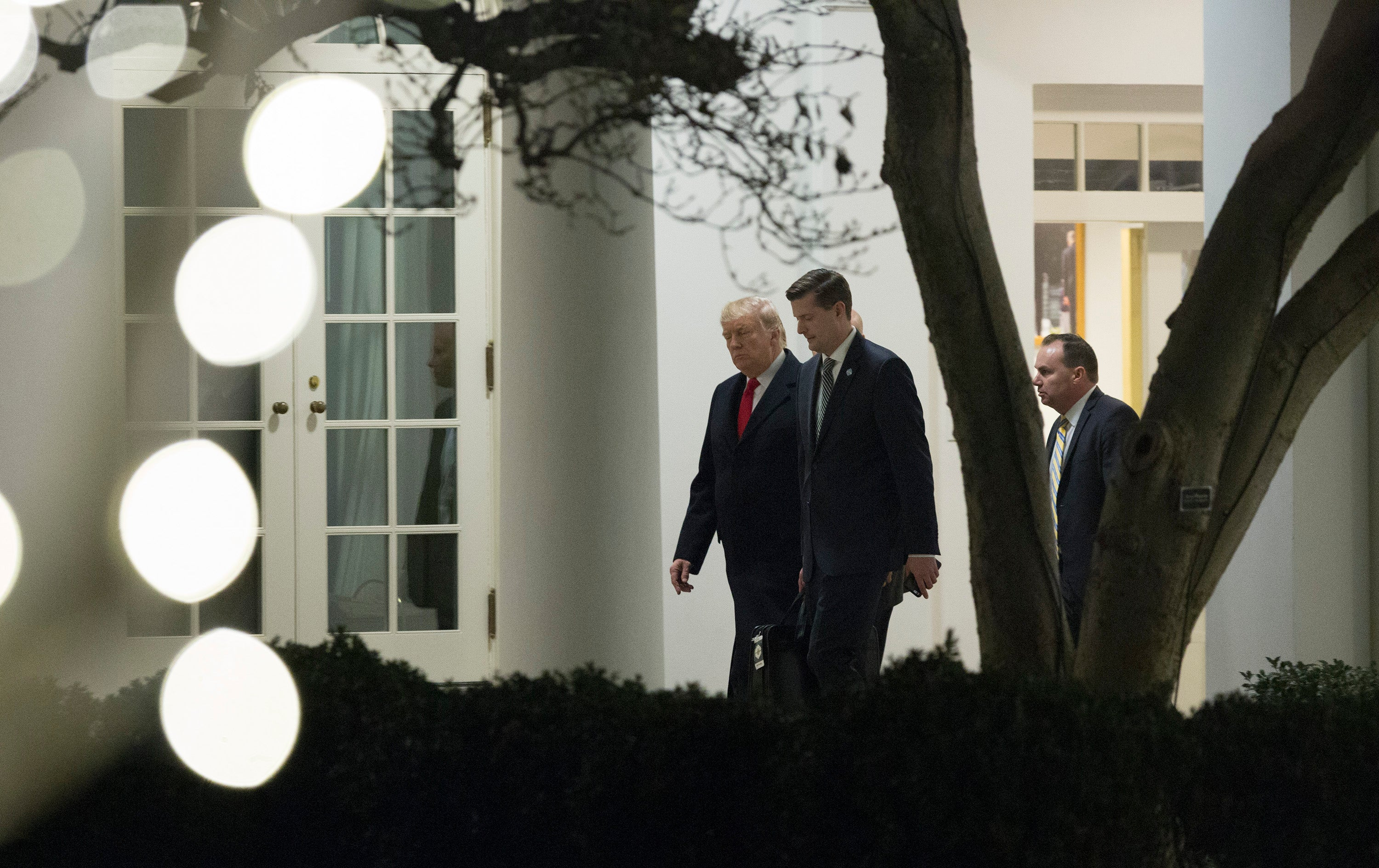 Donald Trump with Rob Porter and Utah Sen. Mike Lee on Dec. 4, 2017.