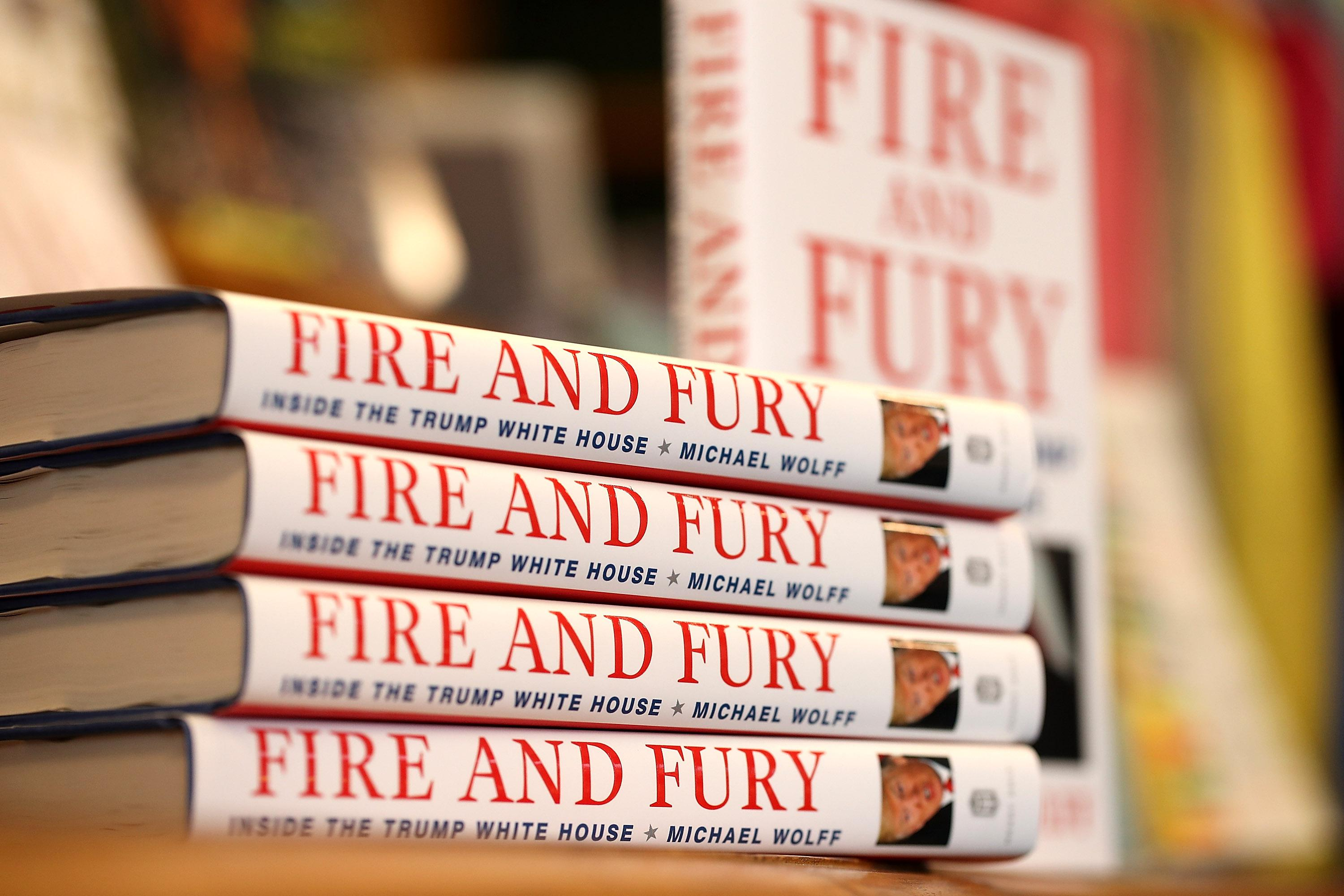 Copies of the book Fire and Fury by author Michael Wolff are displayed on a shelf at a bookstore