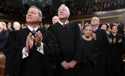 Supreme Court Justices Chief Justice John Roberts, Anthony Kennedy, Ruth Bader Ginsburg, Stephen Breyer, Sonia Sotomayor and Elena Kagan (L-R) applaud prior to President Obama's State of the Union speech on Capitol Hill in Washington.