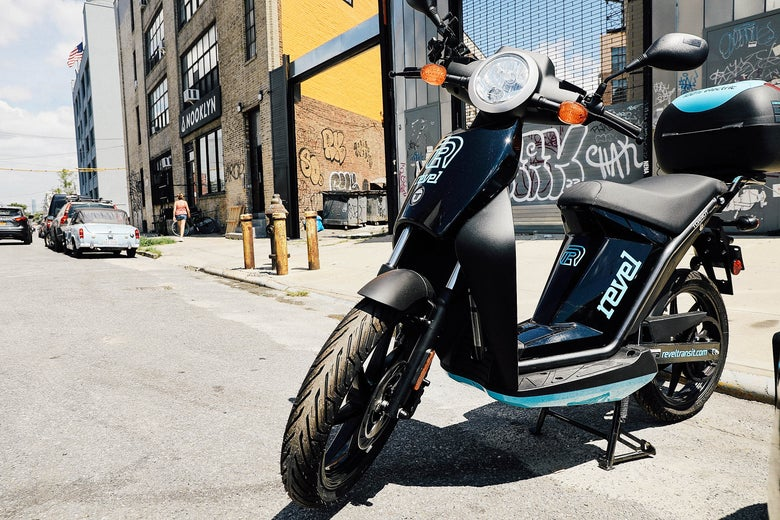 A Revel moped sits outside the company's headquarters.