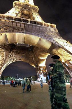 French army soldiers are on patrol at the Eiffel Tower. Click image to expand.