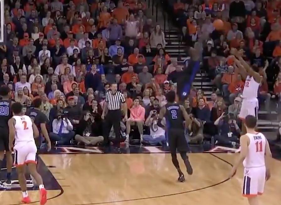 Zion Williamson soars for the block against Virginia.