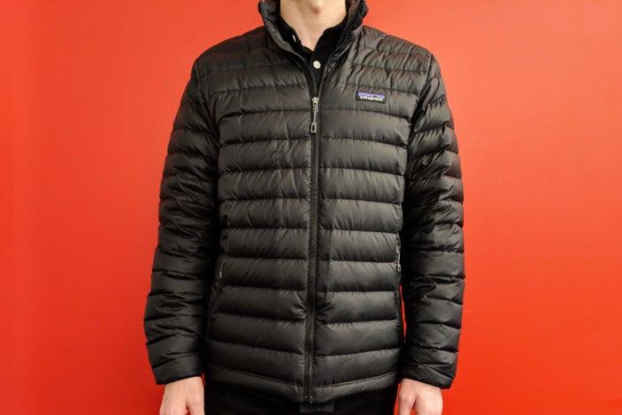 Man wearing black Patagonia puffer jacket.