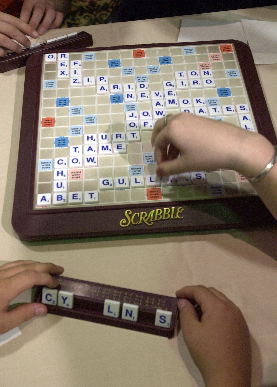 World Champion Scrabble player Panupol Sujjayakorn (L) plays John Lawrence.