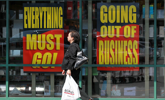 A Borders Books customer walks by signs advertising a going out of business sale at a Borders Bookstore on July 22, 2011 in San Francisco, California.