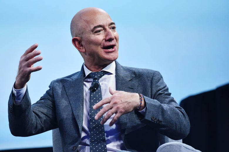 Jeff Bezos gestures as he speaks onstage at the Washington Convention Center.