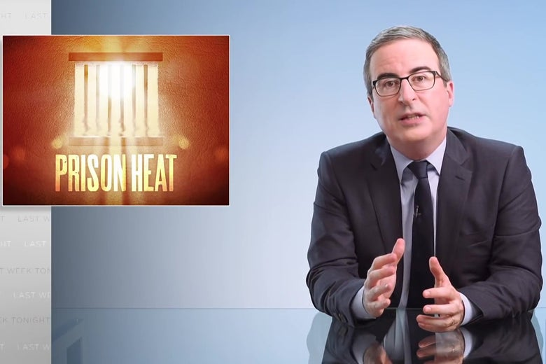 """John Oliver sits at a glass anchorperson's desk, in front of an image that is labeled """"Prison Heat."""""""
