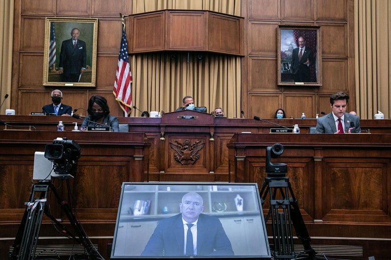 Bezos on a videoconference screen in front of a panel of seated House members in the hearing room