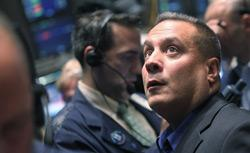 Traders work on the floor of the New York Stock Exchange. Click image to expand.