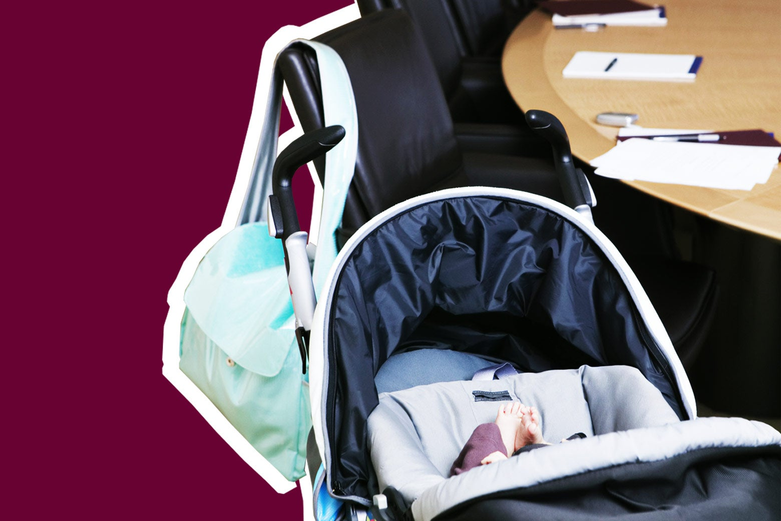 Stroller with an infant in it next to a corporate meeting table.