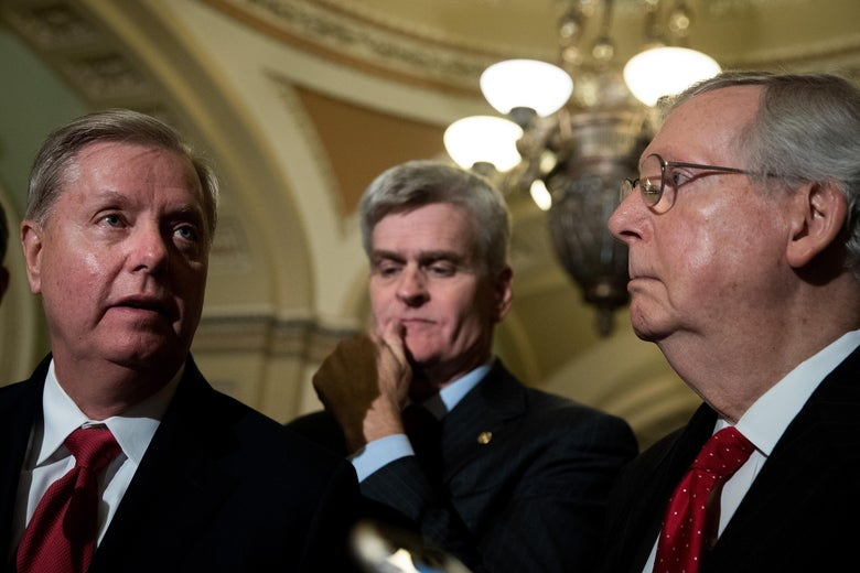 Lindsey Graham (R-SC), Bill Cassidy (R-LA) and Majority Leader Mitch McConnell (R-KY) take questions from reporters during a news conference following their weekly policy luncheon, September 26, 2017 in Washington, D.C.