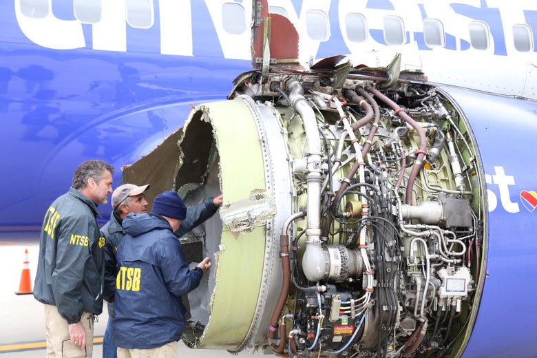 The plane's damaged and exposed left engine.